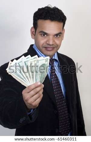 Success business man with dollars in hand - stock photo