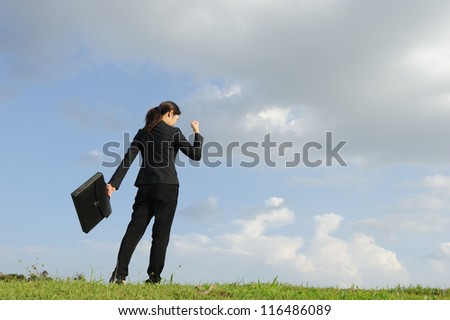 Success business woman and blue sky