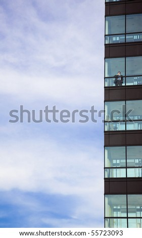success businessman standing in  modern office building and drink coffee - stock photo