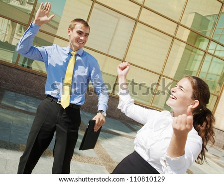 Success concept: businesspeople raising hands and clapping
