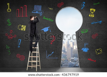 Success concept with businessman on ladder looking through keyhole shaped door with city view in concrete room with colorful business charts on wall