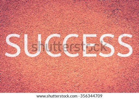 Success concept with word on running track,Red running tracks  run lane background texture,vintage color - stock photo