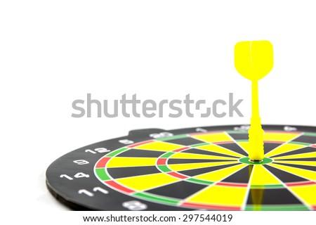 Success: dartboard and darts in bulls-eye - stock photo