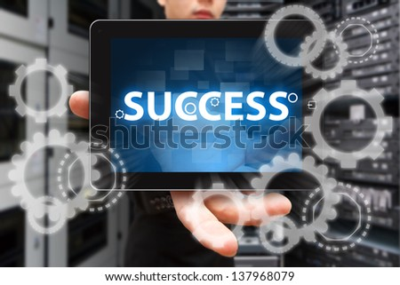 Success Gear from digital tablet - stock photo