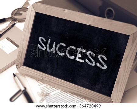 Success Handwritten by White Chalk on a Blackboard. Composition with Small Chalkboard on Background of Working Table with Office Folders, Stationery, Reports. Blurred Background. Toned 3d Image. - stock photo