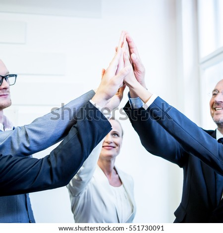 Success high five hands of business people, Caucasian European team in office environment