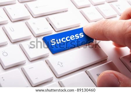 success in business concept with key on computer keyboard - stock photo
