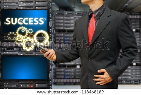 Success in data center room by programmer - stock photo