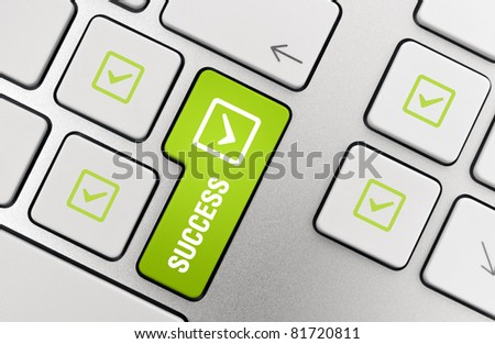 Success Key concept. Button with success text and check mark symbols on modern aluminum computer keyboard. - stock photo