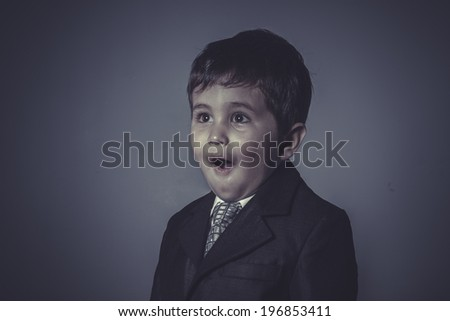 success little business boy over grey background - stock photo