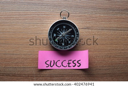 Success : Motivation advice handwriting on label with compass - stock photo
