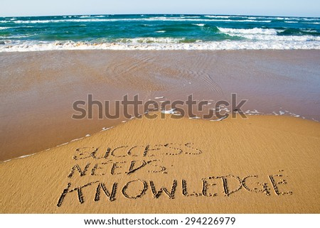 Success needs knowledge. Creative motivation concept written in the sand at the beach. - stock photo