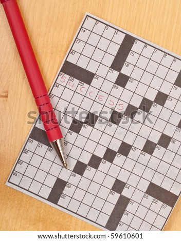 Success on a Crossword Puzzle - stock photo
