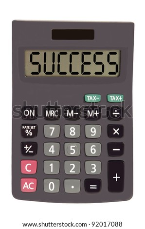 success on display of an old calculator on white background