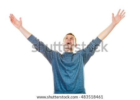 Success positive emotions. Happy young man successful lad with arms up looking upwards isolated on white background