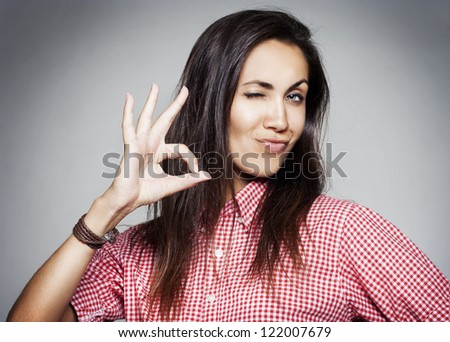 Success pretty woman showing hand ok sign - stock photo