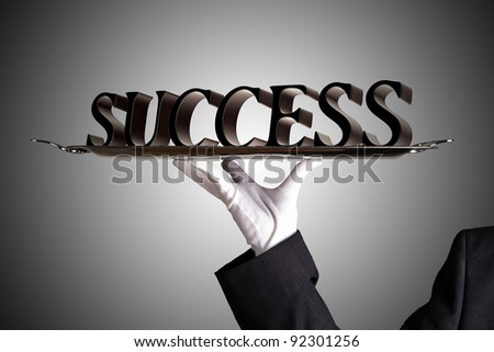 Success served on a dinner tray - stock photo