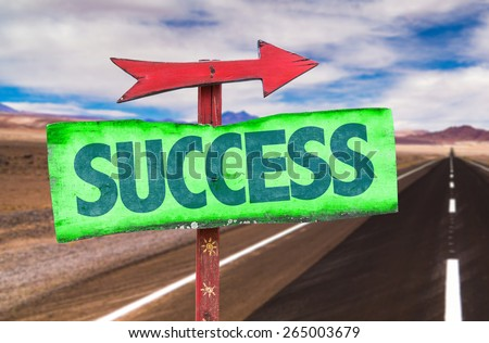 Success sign with road background - stock photo