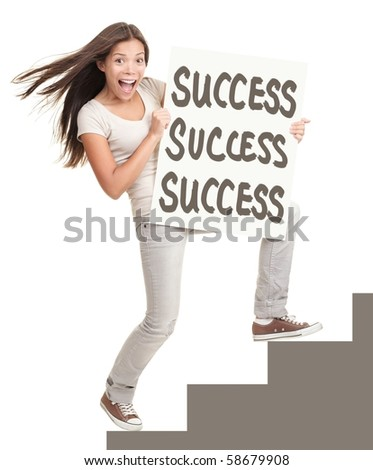 Success sign. Young successful woman showing success sign climbing stairs. Isolated on white background in full length. - stock photo