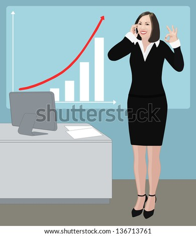 Success smiling business woman has just received good news from her phone conversation about sales rising or career promotion so she shows ok sign, attractive brunette dressed black and white office