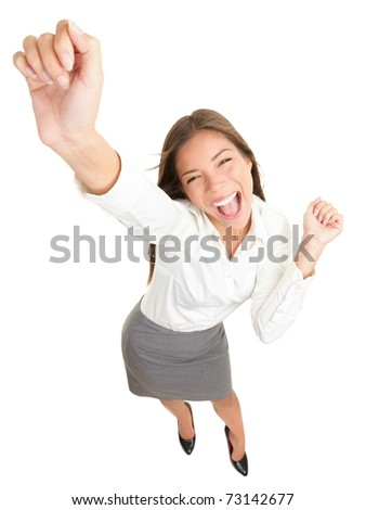 Success. Successful businesswoman cheering and dancing celebrating victory. Dynamic high angle view of young beautiful Asian Caucasian casual business woman. Isolated on white background in full body. - stock photo