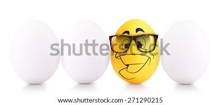 Success Symbol Concept. white Easter Egg standing out from the others - stock photo