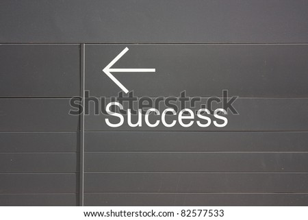 success way sign on gray metal background