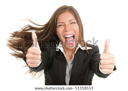 Success woman excited giving thumbs up. Young smiling mixed Chinese Asian / Caucasian businesswoman. Isolated on white background - stock photo