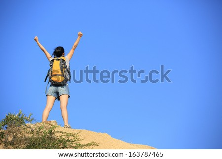 success woman hiker open arms mountain peak - stock photo