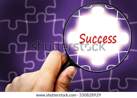 Success word. Magnifier and puzzles. - stock photo