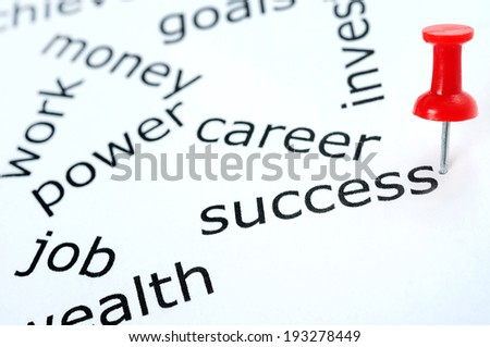 Success word pinned on paper