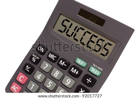 success written on display of an old calculator on white background in perspective - stock photo