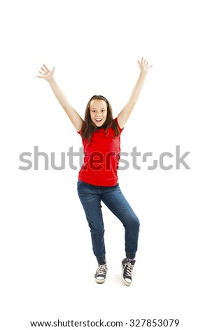 Success young girl dancing and celebrating. Isolated on white background.  - stock photo