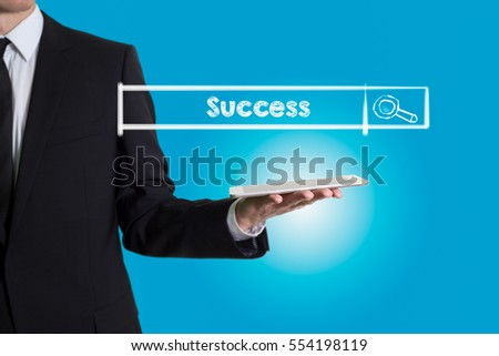 Success, young man holding a tablet computer
