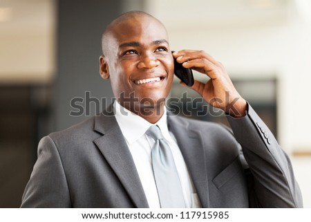 successful african american businessman talking on mobile phone - stock photo