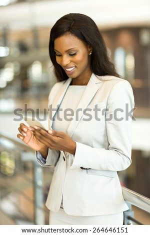 successful african american businesswoman using smart phone in modern office - stock photo