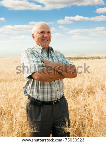 successful agriculturist in field of wheat. harvest time - stock photo