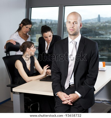 Successful and confident business leader in front of his team - stock photo