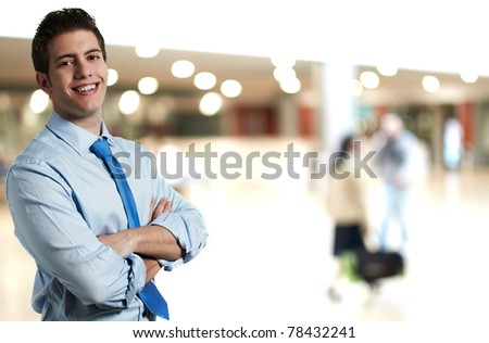 Successful and confident business man smiling at his office - stock photo