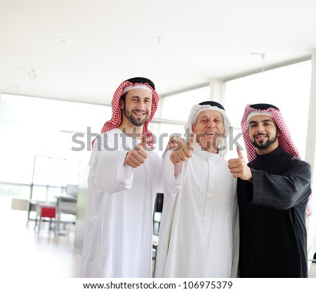 Successful and happy business arab people with thumbs up - stock photo