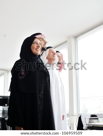 Successful and happy business arabic  people looking up - stock photo