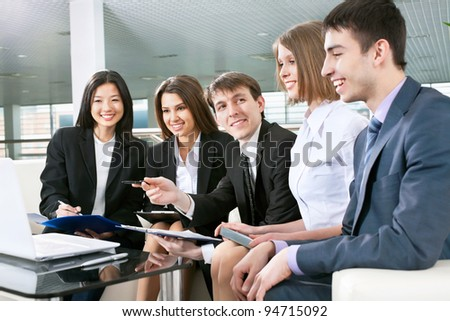 Successful and happy business people sitting for a meeting - stock photo