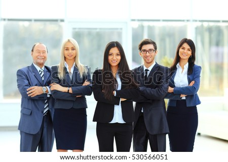 successful and happy business team on office background