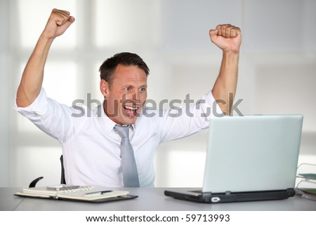 Successful and happy businessman - stock photo