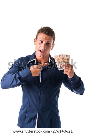 Successful and happy young man with euro bills or banknotes in his hands