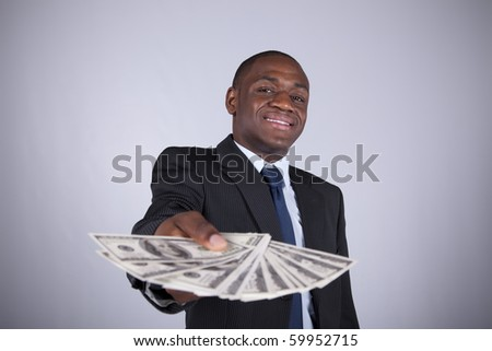 Successful and wealthy african businessman showing you money (isolated on white) - stock photo
