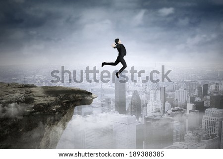 Successful asian businesswoman jumping against city background