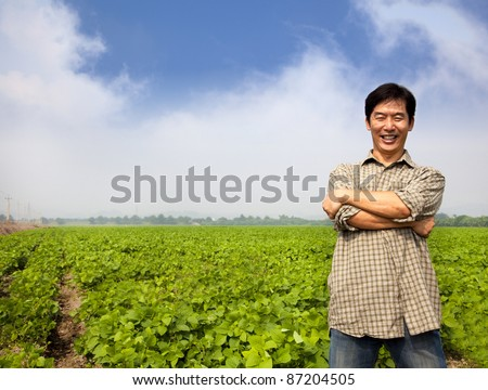 successful asian middle-aged farmer - stock photo