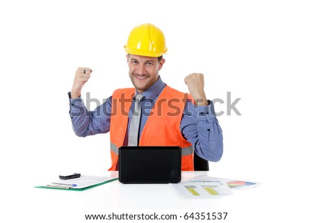 Successful attractive caucasian man architect with safety helmet in the office with laptop, clenched fists. Studio shot. White background. - stock photo