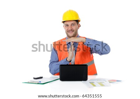 Successful attractive caucasian man architect with safety helmet in the office with laptop gesturing time out. Studio shot. White background. - stock photo